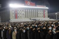 People watch the flag raising ceremony and fireworks display to celebrate the New Year, at Kim Il Sung Square in Pyongyang, North Korea, early Friday, Jan., 1, 2021. (AP Photo/Jon Chol Jin)