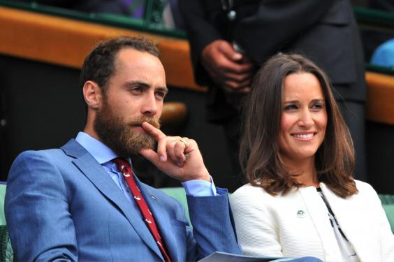 Pippa Middleton (R) and James Middleton (L), sister and brother of Catherine, Duchess of Cambridge, sit together in the Royal Box on Centre Court on day four of the 2014 Wimbledon Championships at The All England Tennis Club in Wimbledon, southwest London, on June 26, 2014. (Getty Images)
