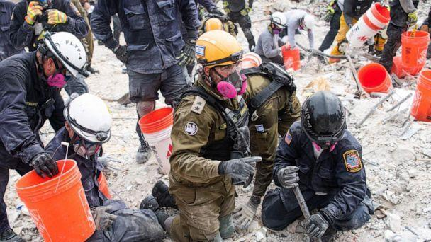 PHOTO: Israeli Defense Forces (IDF) search and rescue team members work in the rubble of Champlain Towers South, in Surfside, Fla., near Miami Beach, June 29, 2021. (Israel Defense Forces)