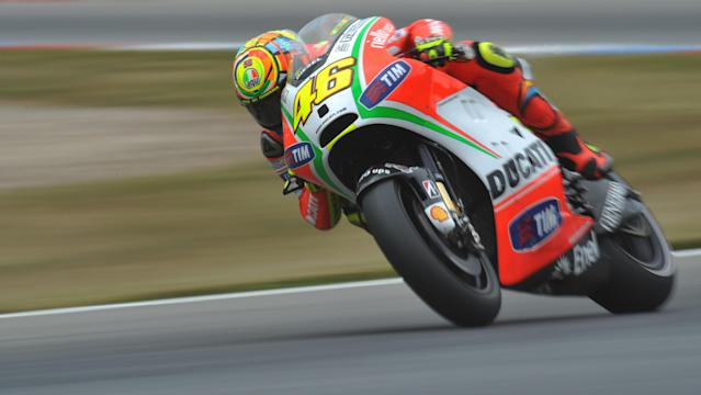 Italy's Valentino Rossi rides his Ducati to sixth place during the qualifying pratice session of the Czech Republic Grand Prix in Moto GP on August 25, 2012 in Brno ahead of the Grand prix on August 26. Spain's Jorge Lorenzo secured pole position ahead of Enlgand's Cal Crutchlow and Spain's Dani Pedrosa. AFP PHOTO/ MICHAL CIZEKMICHAL CIZEK/AFP/GettyImages