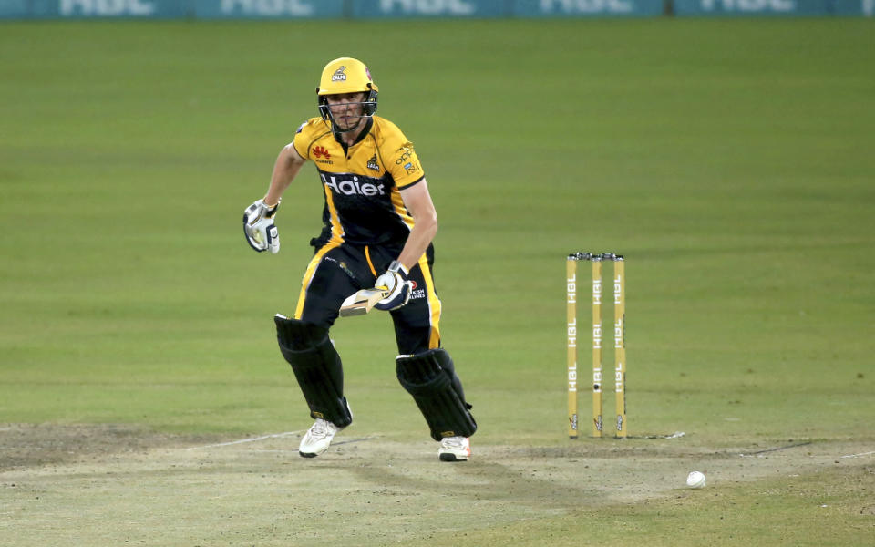 Peshawar Zalmi' Tom Kohler-Cadmore take a score during a Pakistan Super League T20 cricket match between Islamabad United and Peshawar Zalmi at the National Stadium, in Karachi, Pakistan, Saturday, Feb. 27, 2021. (AP Photo/Fareed Khan)