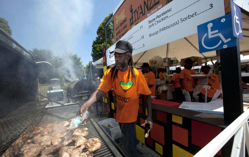 A vendor barbecues chicken at the Taste of Chicago Food Festival on Wednesday, July 11, 2012 in Chicago. (AP Photo/Sitthixay Ditthavong)