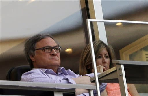 Miami Marlins owner Jeffrey Loria and his wife Julie, right, watch during the first inning of a baseball game between the Miami Marlins and the Atlanta Braves, Monday, April 8, 2013 in Miami. (AP Photo/Wilfredo Lee)