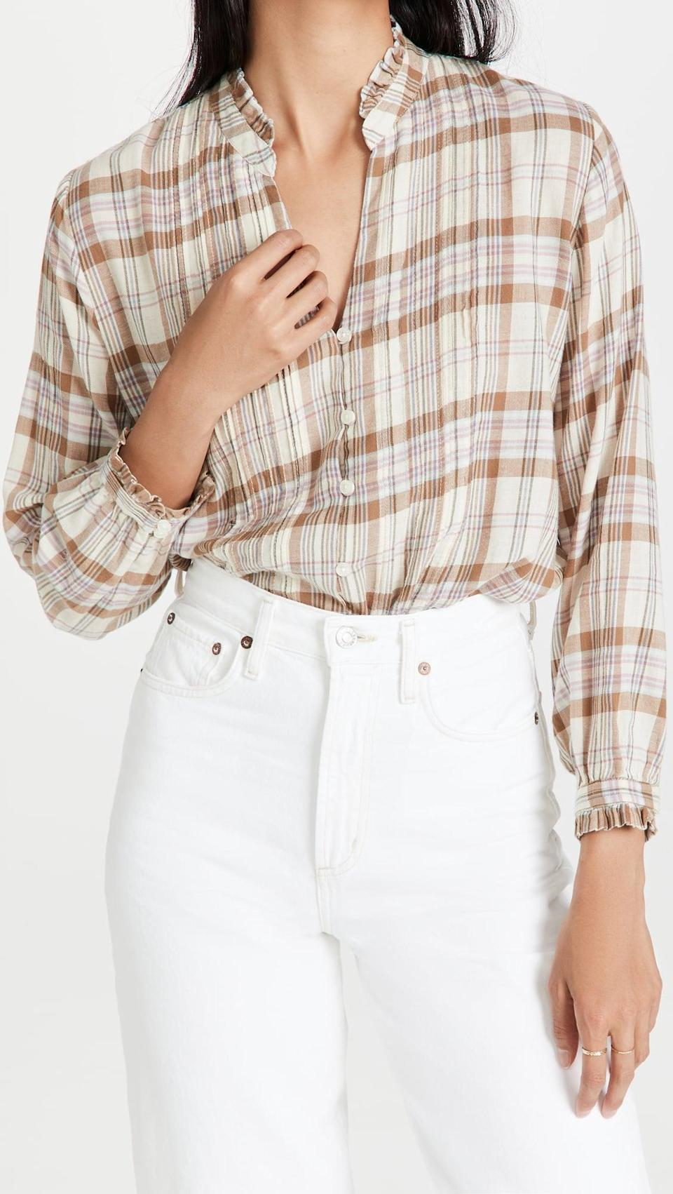 <p>This <span>Birds of Paradis Finley Pintuck Blouse</span> ($238) looks great with all kinds of denim, or even a black miniskirt. Plus, the ruffle details are so pretty.</p>