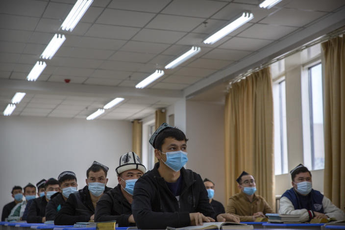Uyghurs and other students listen to an instructor during a class at the Xinjiang Islamic Institute, as seen during a government organized visit for foreign journalists, in Urumqi in western China's Xinjiang Uyghur Autonomous Region on April 22, 2021. Under the weight of official policies, the future of Islam appears precarious in Xinjiang, a remote region facing Central Asia in China's northwest corner. Outside observers say scores of mosques have been demolished, which Beijing denies, and locals say the number of worshippers is on the decline. (AP Photo/Mark Schiefelbein)