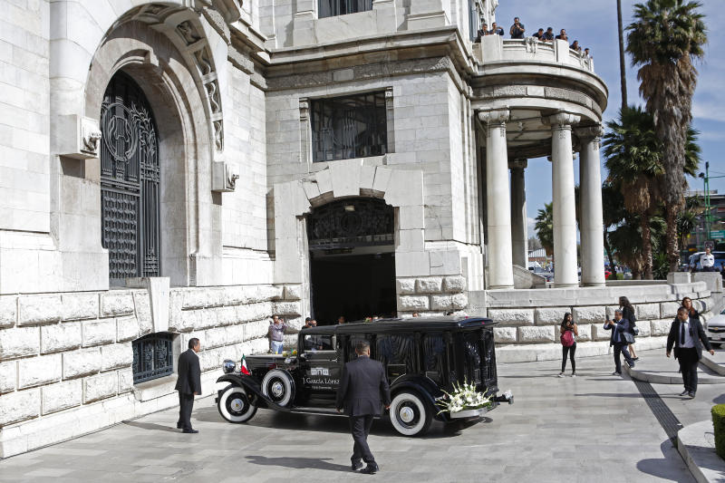 A hearse carrying ashes of Mexican singer Jose Jose arrives to the Palace of Fine Arts in Mexico City, Wednesday, Oct 9, 2019. Jose Jose died Sept. 28 in South Florida. His body was cremated in Miami, and it was agreed after a dispute among relatives over his remains, that half the ashes would remain there and the other half would be brought to Mexico. (AP Photo/Ginnette Riquelme)