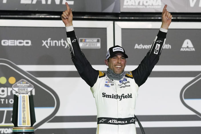 Aric Almirola celebrates in Victory Lane after winning the first of two qualifying NASCAR auto races for the Daytona 500 at Daytona International Speedway, Thursday, Feb. 11, 2021, in Daytona Beach, Fla. (AP Photo/John Raoux)