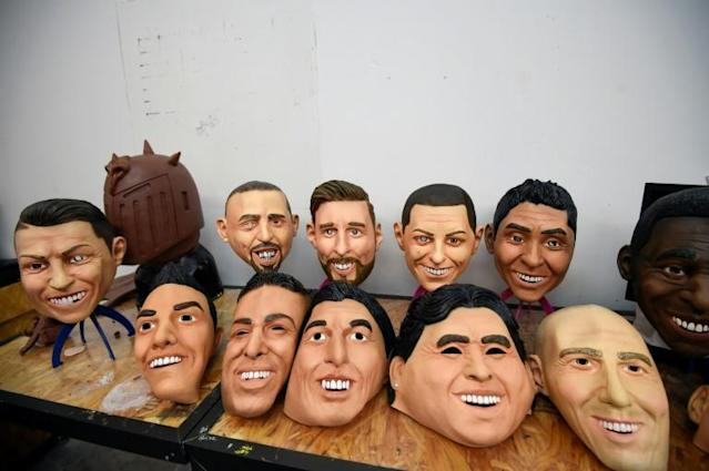 View of latex masks of football players (L to R back to front) Cristiano Ronaldo, Franck Ribery, Lionel Messi, Javier Hernandez, Jorge Campos, Pele, Hirving Lozano, Neymar, Luis Suarez, Diego Armando Maradona, Zinedine Zidane are displayed at a factory in Jiutepec, Morelos State, Mexico