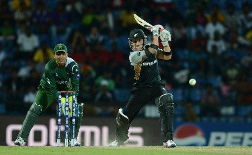 Pakistan wicket keeper Kamran Akmal watches as New Zealand batsman Brendon McCullum