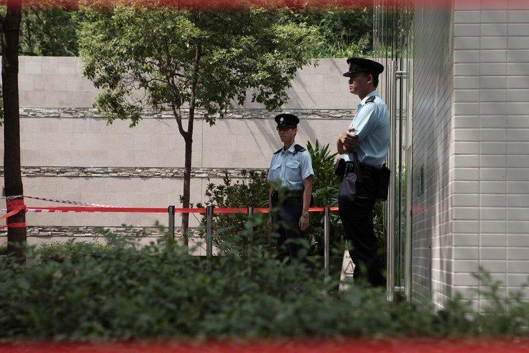 Image taken on October 3, 2012 shows police standing guard outside a cordoned-off building in Hong Kong
