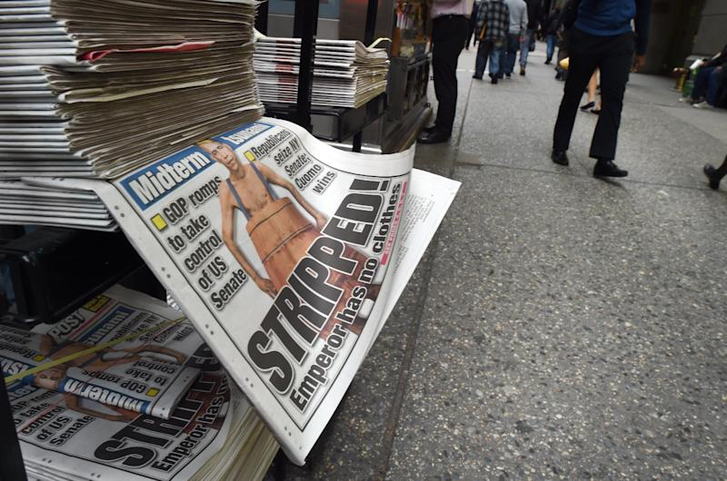 A newspaper with headlines featuring the election results are seen at a stand in New York November 5, 2014, the morning after Republicans took the Senate away from Democrats in the midterm elections (AFP Photo/Timothy A. Clary)