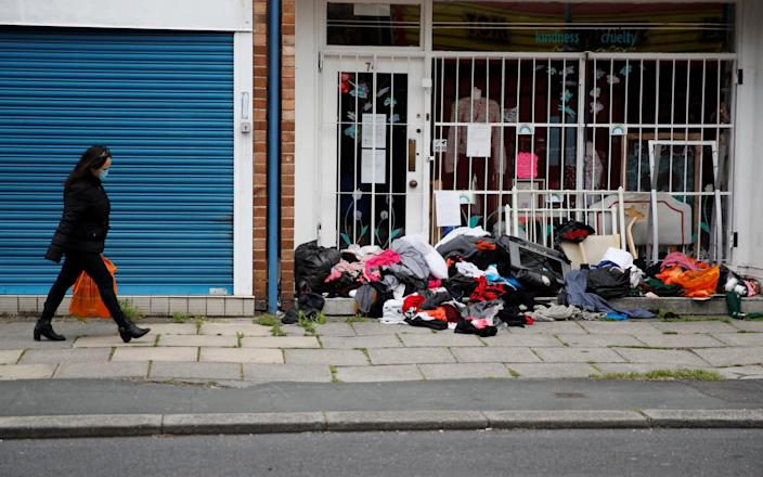A charity shop with piles of donations outside - Phil Noble/Reuters