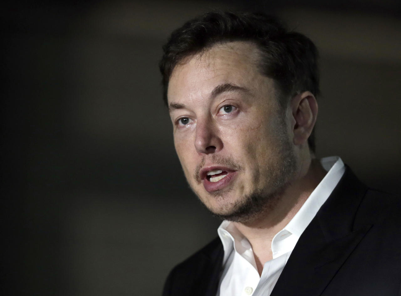 FILE - In a Thursday, June 14, 2018 file photo, Tesla CEO and founder of the Boring Company Elon Musk speaks at a news conference, in Chicago. Whether it's investors betting against his stock, reporters or analysts who ask tough questions or a union trying to organize his workers, Elon Musk has fought back, often around the clock on Twitter. But when Musk called a British diver involved in the Thailand cave rescue a pedophile to 22.3 million Twitter followers on July 15, he may have gone one tweet too far. (AP Photo/Kiichiro Sato, File)