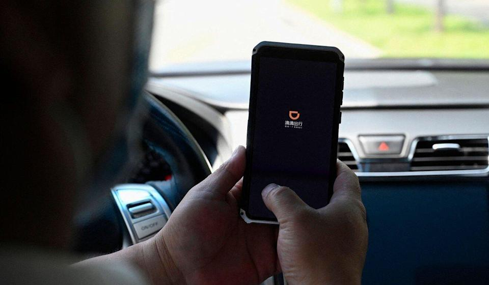 A driver opens the Didi Chuxing app on his smartphone in Beijing, in July 2021. Photo: AFP