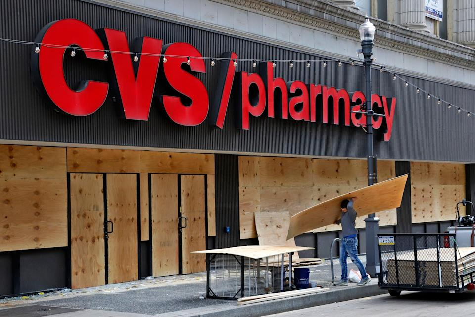 Windows broken in a downtown Pittsburgh CVS Pharmacy are boarded up on May 31, 2020.
