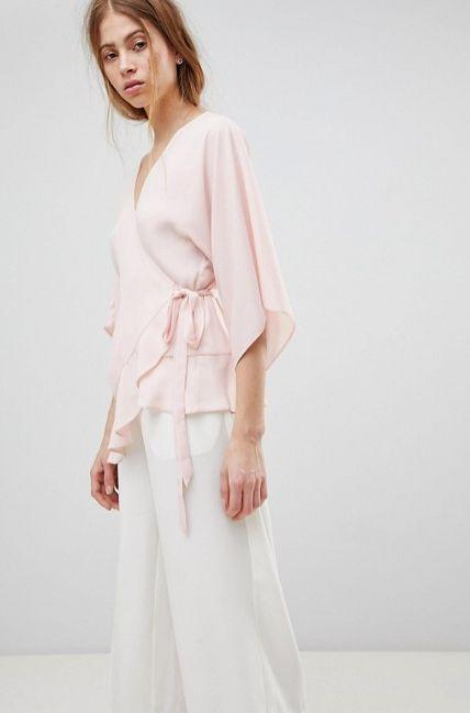 "Get it <a href=""http://us.asos.com/asos/asos-design-wrap-top-with-kimono-sleeve/prd/9563817?clr=blush&SearchQuery=wrap%20top&gridcolumn=3&gridrow=17&gridsize=4&pge=1&pgesize=72&totalstyles=426"" target=""_blank"">here</a>."