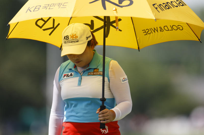 Inbee Park, of South Korea, protects herself from the sun as she approaches the first green during the first round of the Marathon Classic golf tournament at Highland Meadows Golf Club in Sylvania, Ohio, Thursday, July 18, 2013. (AP Photo/Rick Osentoski)