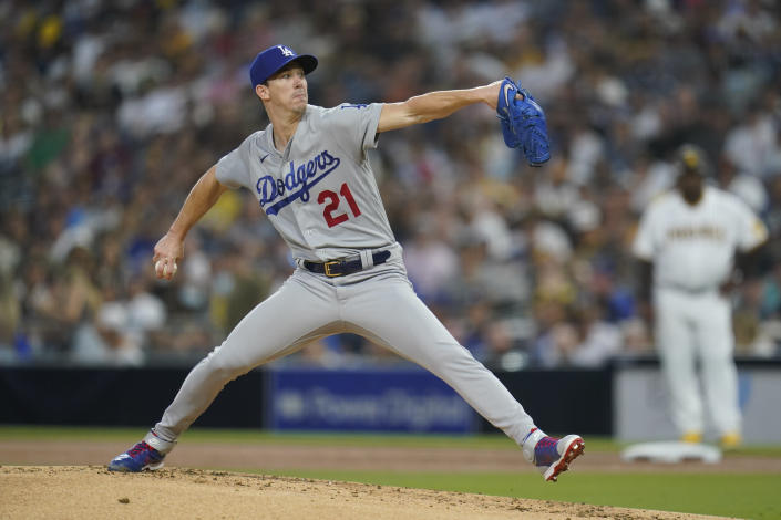 Los Angeles Dodgers starting pitcher Walker Buehler works against a San Diego Padres batter during the first inning of a baseball game Wednesday, Aug. 25, 2021, in San Diego. (AP Photo/Gregory Bull)