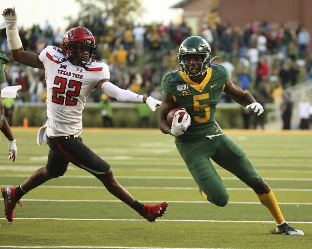 Baylor wide receiver Denzel Mims (5) runs after the catch past Texas Tech cornerback Ja'Marcus Ingram (22) in the during the first overtime of a NCAA college football game in Waco, Tex.,Saturday, Oct. 12, 2019.(AP Photo/Jerry Larson)
