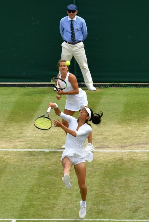 Taiwan's Hsieh Su-Wei reaches for a return on Court Two (AFP Photo/GLYN KIRK)