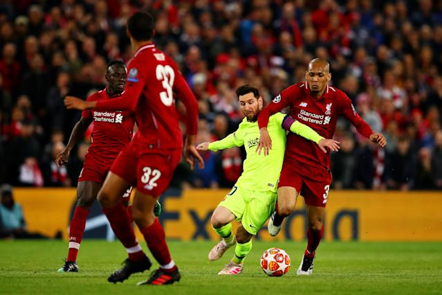 Lionel Messi of FC Barcelona is challenged by Fabinho of Liverpool during the UEFA Champions League Semi Final second leg match between Liverpool and Barcelona at Anfield on May 07, 2019 in Liverpool, England. (Photo by Chris Brunskill/Fantasista/Getty Images)