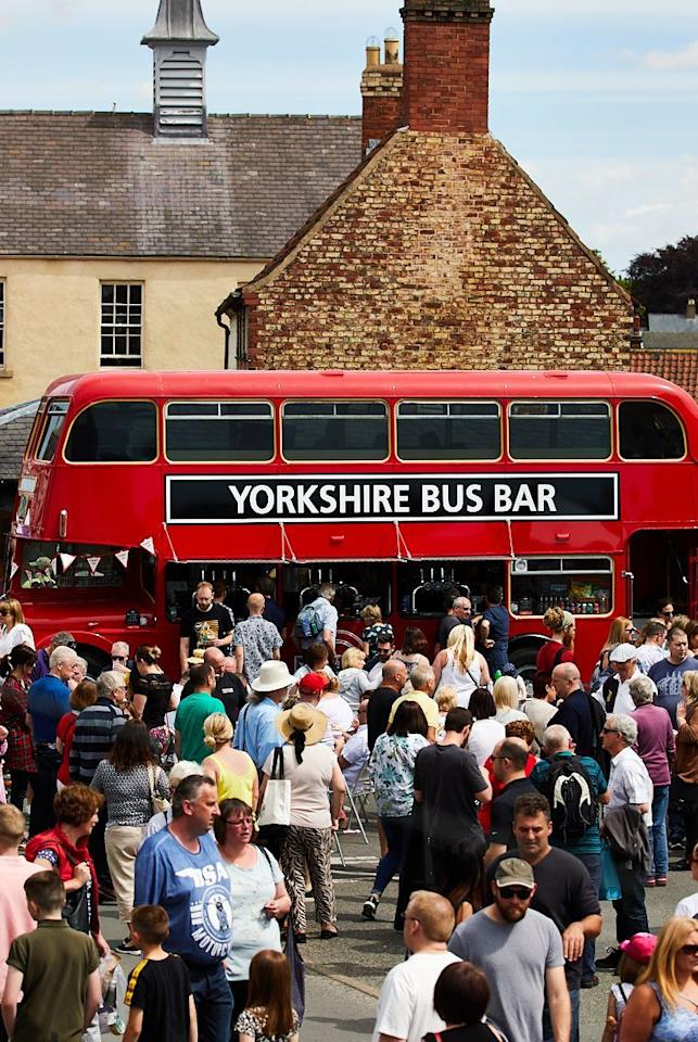 "<p>This village in Yorkshire describes itself as 'Yorkshire's food capital.' And it lives up to its name with this three-day event that sees thousands descend on the market town to enjoy the producer's market, delicious street food, talks, tastings and demos. </p><p><strong>Go for: </strong>The 160+ food and drink street vendors, eating your way around the town to the sound of live music and brass bands. Fingers crossed for the sunshine! <strong></strong></p><p><strong>Stay for:</strong> The celeb chef line-up on the Main Stage, led by festival patron Tommy Banks who will host impressive demonstrations inspired by his award-winning restaurants, Roots York and The Black Swan at Oldstead. </p><p>Malton Food Lovers Festival takes place 23 - 25 May in Malton.</p><p><strong><a class=""body-btn-link"" href=""https://www.visitmalton.com/food-festival-yorkshire"" target=""_blank"">MORE INFO</a></strong></p>"