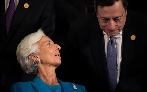 Mario Draghi (right) with Christine Lagarde - Credit:  FRED DUFOUR/ AFP