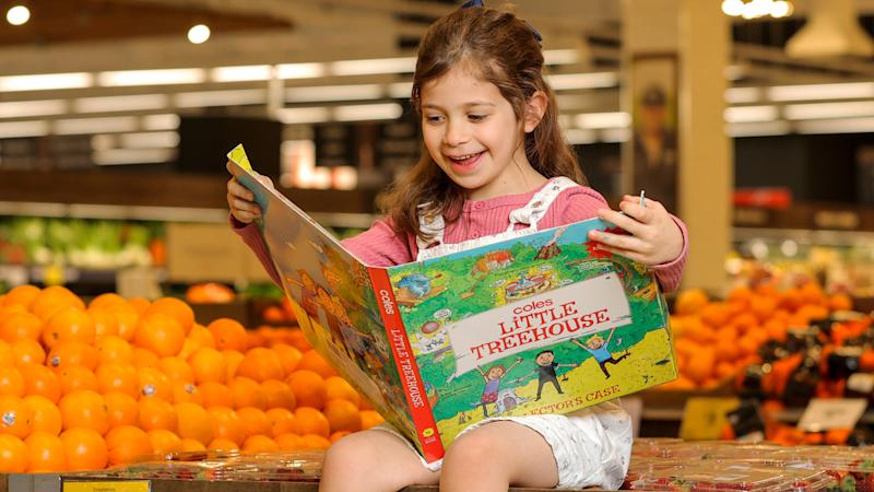 A young girl seen reading Coles Little Treehouse Books.