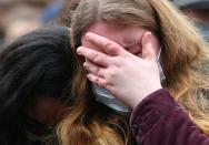 A person reacts at the site where a car crashed into pedestrians in Trier