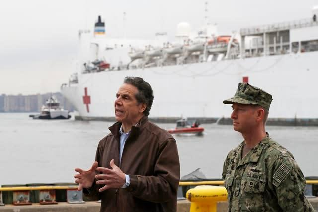 Andrew Cuomo with the USNS Comfort, a naval hospital ship (Kathy Willens/AP)