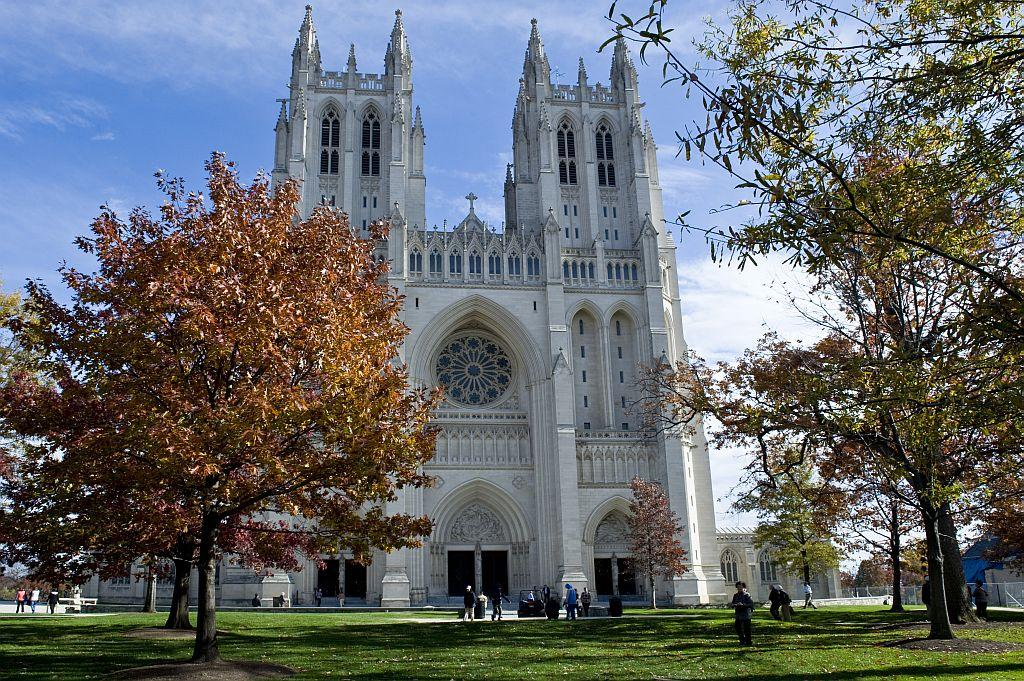 People gather before services on a glorious fall day at the National Cathedral in Washington, DC.