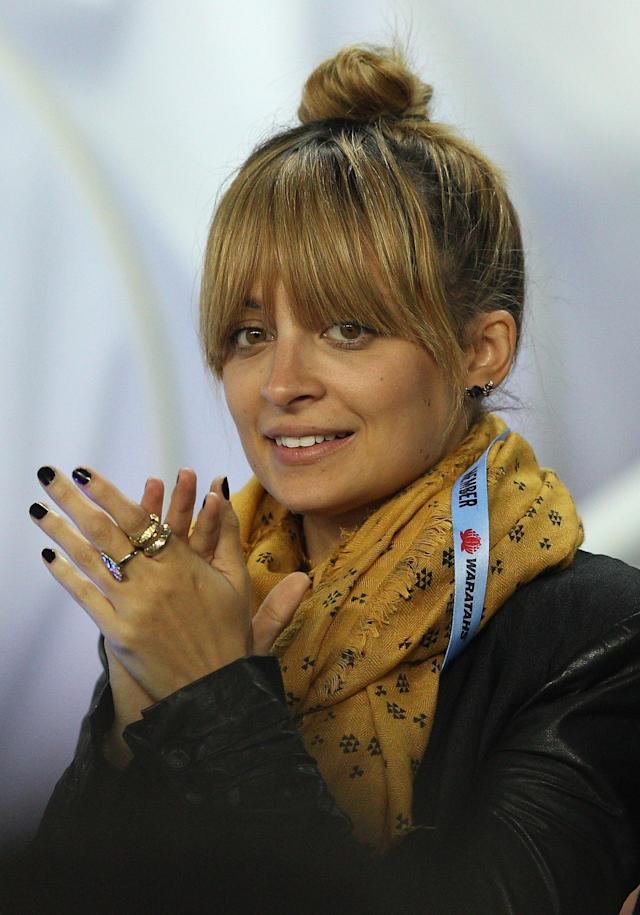 SYDNEY, AUSTRALIA - MAY 11: Nicole Richie watches the action during the round 12 Super Rugby match between the Waratahs and the Bulls at Allianz Stadium on May 11, 2012 in Sydney, Australia. (Photo by Cameron Spencer/Getty Images)