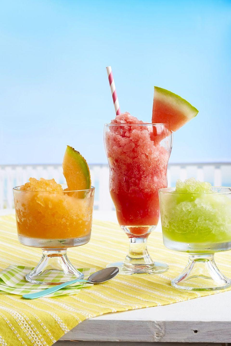 """<p>Pick your favorite: watermelon-lime, honeydew-ginger-mint or cantaloupe-basil shaved ice (or try all three!).</p><p><em><a href=""""https://www.womansday.com/food-recipes/food-drinks/recipes/a59422/summer-melon-slushies-recipe/"""" rel=""""nofollow noopener"""" target=""""_blank"""" data-ylk=""""slk:Get the recipe from Woman's Day »"""" class=""""link rapid-noclick-resp"""">Get the recipe from Woman's Day »</a></em></p>"""