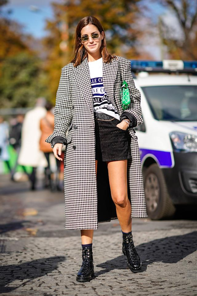 <p>An outer garment worn outdoors that has sleeves and typically extends below the hips.</p>