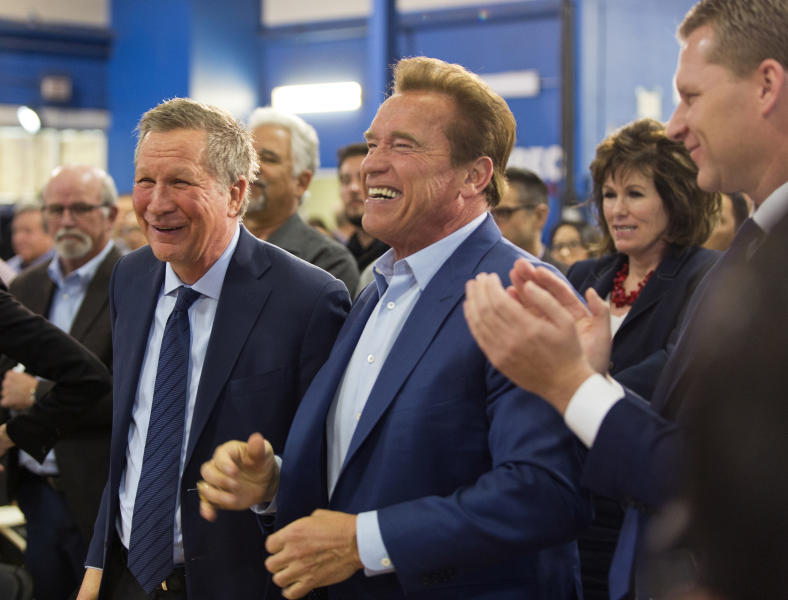 Republican centrists, from left, Ohio Gov. John Kasich, former California Gov. Arnold Schwarzenegger, and New Way California founder, Assemblyman Chad Mayes, appear at the first New Way California Summit, a political committee eager to reshape the state GOP, at the Hollenbeck Youth Center in Los Angeles Wednesday, March 21, 2018. (AP Photo/Damian Dovarganes)