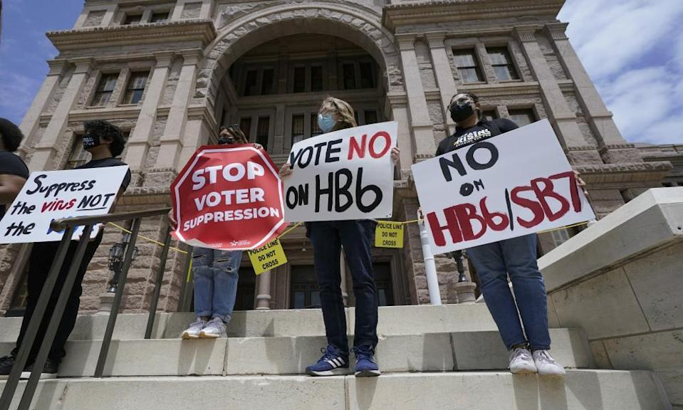 People protest against the HB6 and SB7 voter bills in Texas. Republican lawmakers around the country are pressing ahead with efforts to tighten voting laws, despite growing warnings from business leaders that the measures could harm democracy and the economic climate.