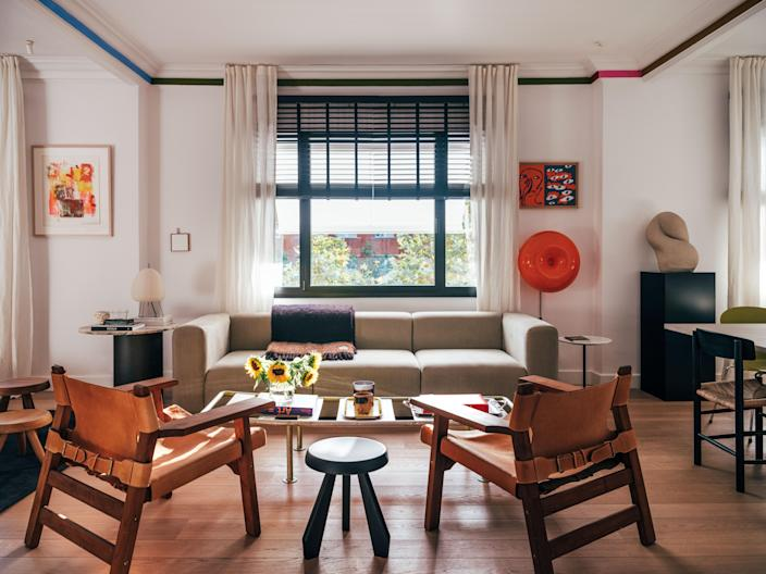 Wood and leather chairs by Heaps & Woods create an immediate warmth in the living room. Robert Rauschenberg's Storyline II lithograph, one of Juan's most prized prints, brings the room together with vibrant hues and a buoyant mood.