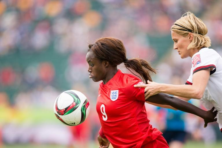 British MP Damian Collins's committee recently delved into racism and bullying allegations made by England women's international footballer Eni Aluko (C)