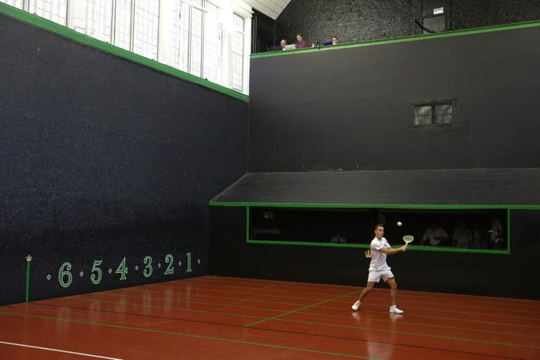 John Lumley warming up before playing a match at the Real Tennis Champions Trophy at Hampton Court Palace, south-west London, on July 20, 2018