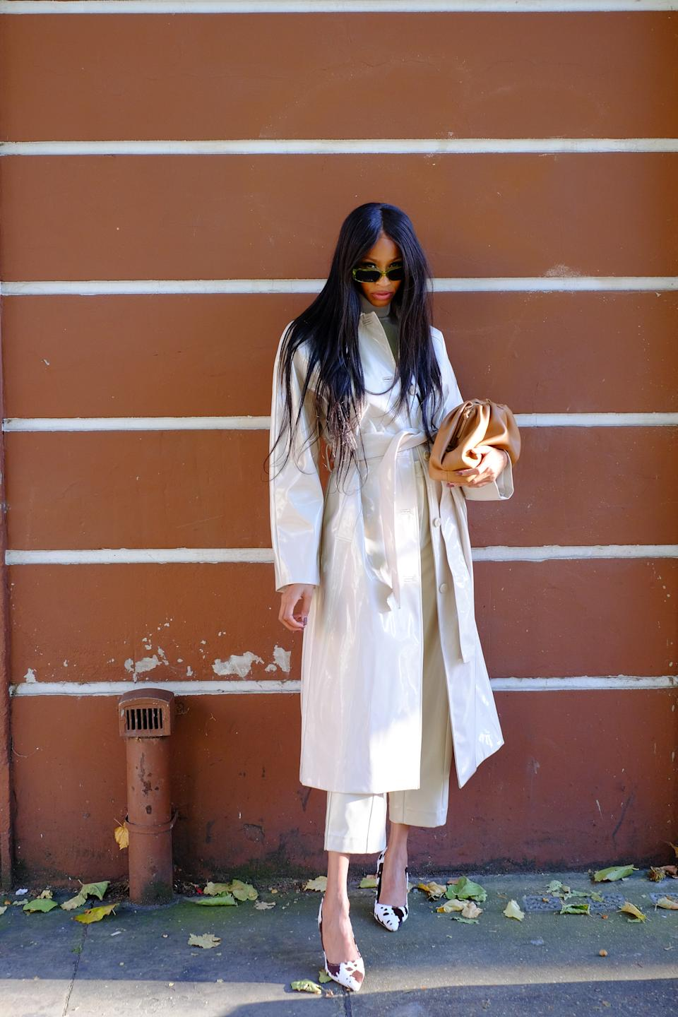 Designer Rachael Broussard is seen wearing a sleek white trench coat and cow print heels. [Photo: PA]