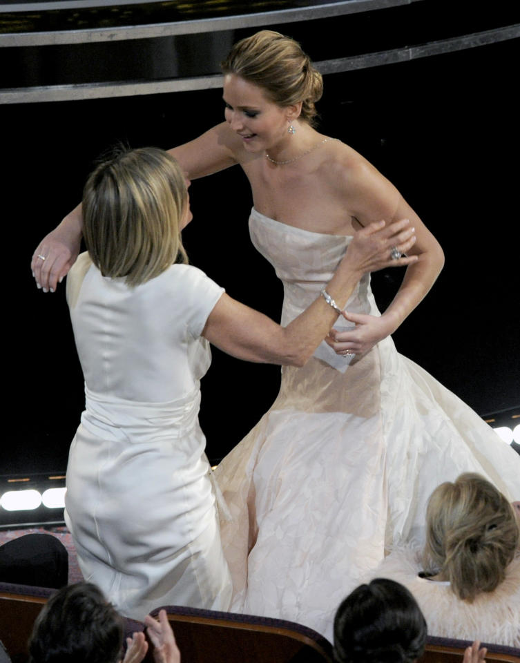 "Karen Lawrence, left, congratulates her daughter Jennifer Lawrence after she is announced as the winner of the award for best actress in a leading role for ""Silver Linings Playbook"" during the Oscars at the Dolby Theatre on Sunday Feb. 24, 2013, in Los Angeles. (Photo by Chris Pizzello/Invision/AP)"
