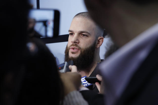 Chicago White Sox's Dallas Keuchel talks with reporters during the team's annual fan convention Friday, Jan. 24, 2020, in Chicago. (AP Photo/Charles Rex Arbogast)