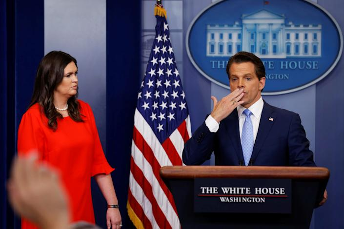White House Communications Director Anthony Scaramucci, flanked by White House Press Secretary Sarah Sanders, blows a kiss to reporters after addressing the daily briefing at the White House, July 21, 2017. (Jonathan Ernst/Reuters)