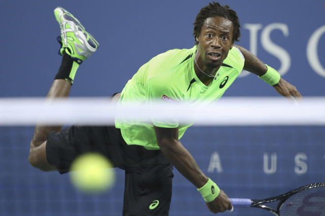 Gael Monfils, of France, watches a serve to Roger Federer, of Switzerland, during the quarterfinals of the U.S. Open tennis tournament, Thursday, Sept. 4, 2014, in New York. (AP Photo/John Minchillo)