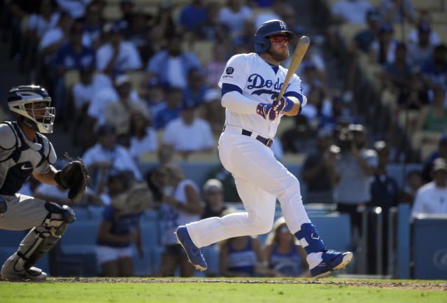 Los Angeles Dodgers' Max Muncy, right, hits a walkoff double as San Diego Padres catcher Francisco Mejia watches during the ninth inning of a baseball game Sunday, Aug. 4, 2019, in Los Angeles. (AP Photo/Mark J. Terrill)