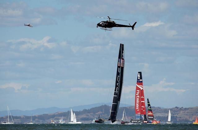 SAN FRANCISCO, CA - SEPTEMBER 25: Oracle Team USA skippered by James Spithill leads Emirates Team New Zealand skippered by Dean Barker on its way to the finish line during race 19 of the America's Cup Finals on September 25, 2013 in San Francisco, California. Oracle Team USA won the race to win the America's Cup. (Photo by Ezra Shaw/Getty Images)