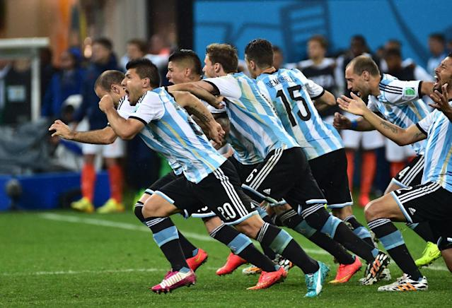Argentina's players to celebrate their victory after a penalty shoot out following extra-time in the semi-final football match between Netherlands and Argentina at The Corinthians Arena in Sao Paulo on July 9, 2014 (AFP Photo/Nelson Almeida)
