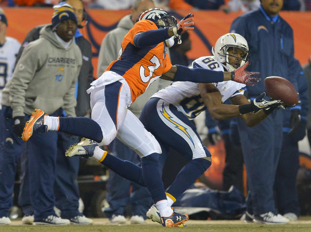 San Diego Chargers wide receiver Vincent Brown (86) catches a pass against Denver Broncos cornerback Kayvon Webster (36) in the third quarter of an NFL football game, Thursday, Dec. 12, 2013, in Denver. (AP Photo/Jack Dempsey)