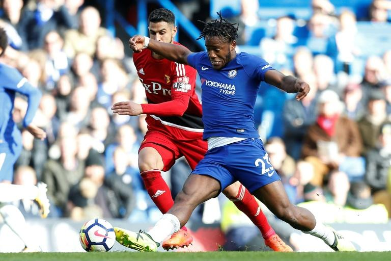Chelsea striker Michy Batshuayi (R) controls the ball during their match against Watford at Stamford Bridge in London on October 21, 2017