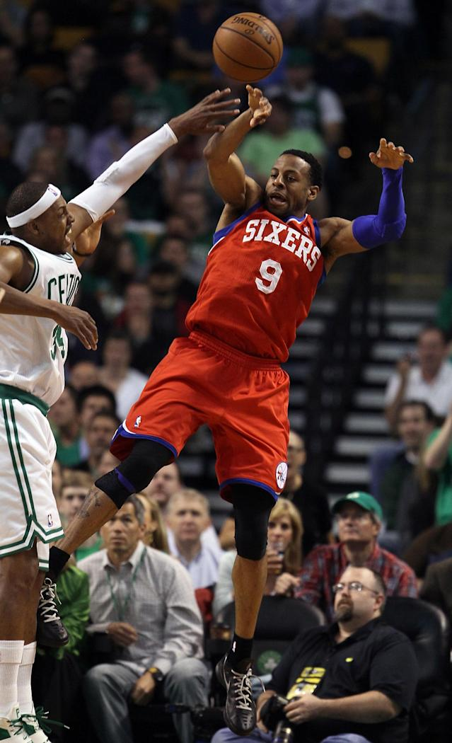 BOSTON, MA - MAY 21: Andre Iguodala #9 of the Philadelphia 76ers passes the ball as Paul Pierce #34 of the Boston Celtics defends in Game Five of the Eastern Conference Semifinals in the 2012 NBA Playoffs on May 21, 2012 at TD Garden in Boston, Massachusetts. NOTE TO USER: User expressly acknowledges and agrees that, by downloading and or using this photograph, User is consenting to the terms and conditions of the Getty Images License Agreement. (Photo by Elsa/Getty Images)